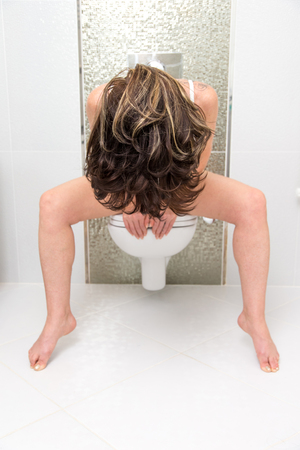 Stressed woman on the toilet