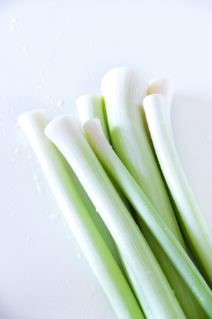 Leeks stack on cutting Board Stock Photo