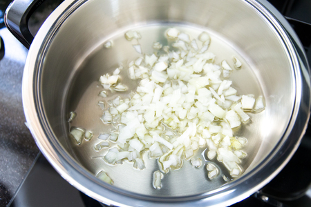 Onion chopped up in the pot Stock Photo