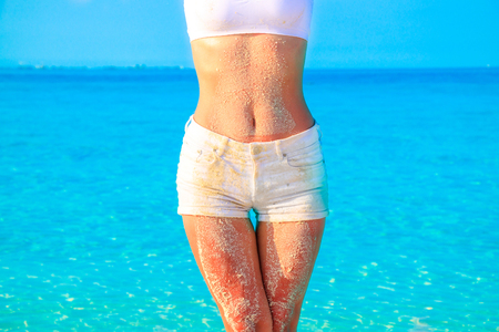 Close-up of belly button woman with hot pants