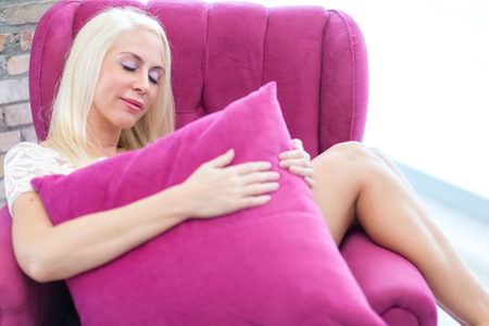 Blonde woman on the couch