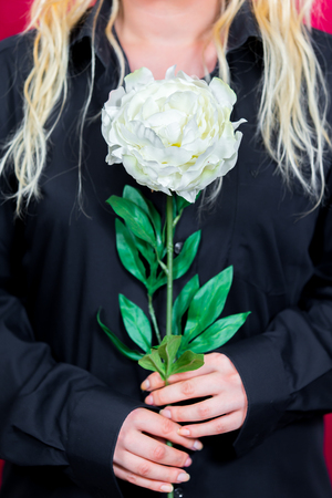 Blonde woman with white Rose