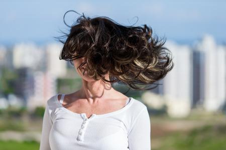 Woman on a balcony Stockfoto