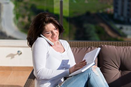 Woman on a balcony Stockfoto - 105524551