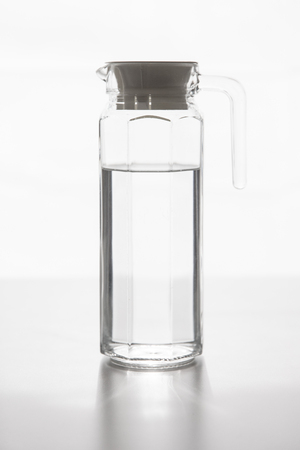 Glass pitcher filled with drinking water