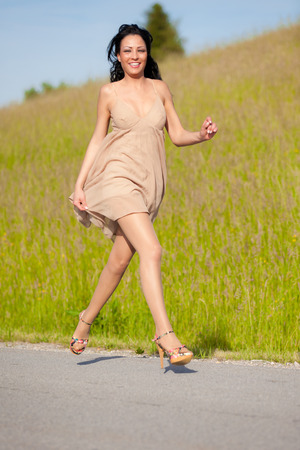 Young beautiful woman runs Stock Photo
