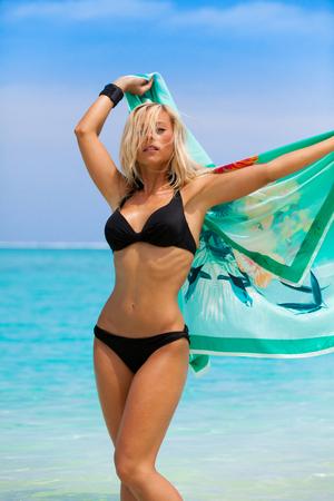 Blonde girl with black bikini in the sea on Maldives Stock Photo
