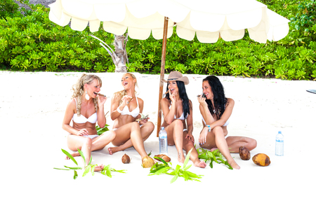 Women robber gang with booty on pirate island Stock Photo