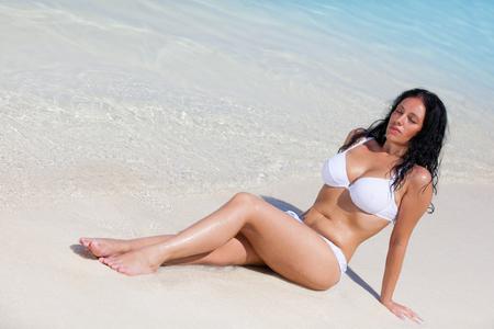 Black haired girl with white bikini in the sea on Maldives Stock Photo