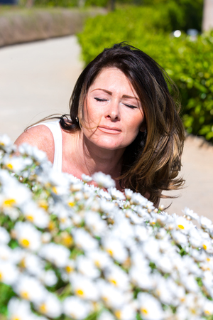 Woman surrounded by chamomile Flowers Stock fotó