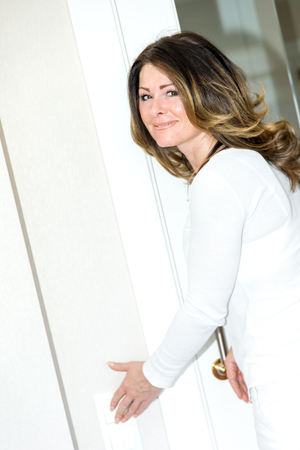 Woman operates light switch