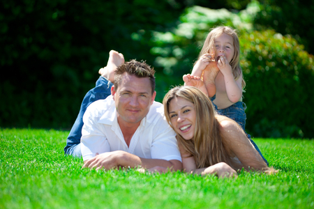 Happy family on summer meadow