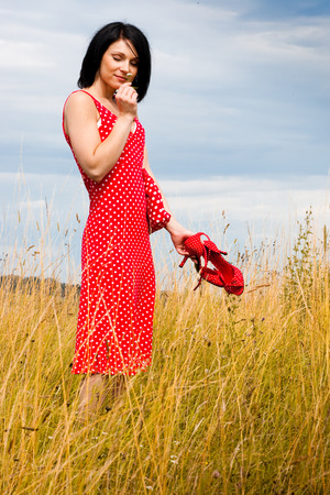 red dress girl in a meadow