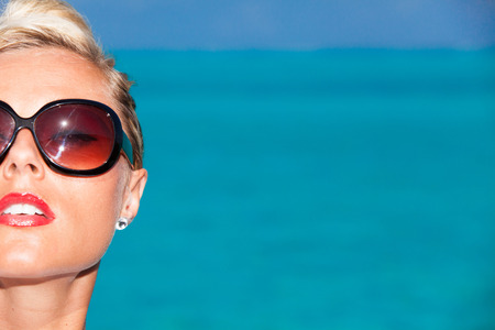 Blonde girl with sunglasses on maldives Stock Photo