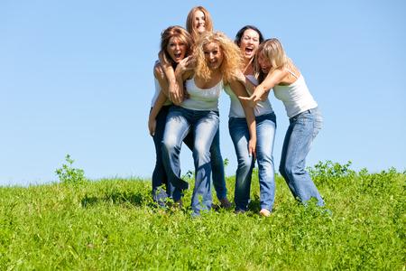 Beautiful girl group in the meadow