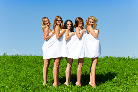 Woman group in towel on the summer meadow Stockfoto
