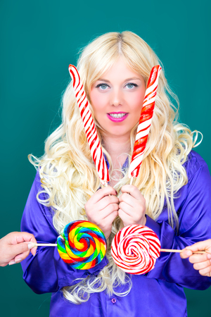 Blonde woman with a Lollipop
