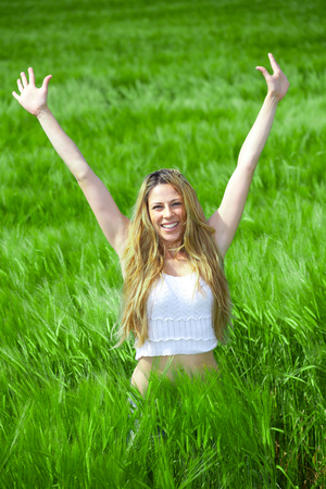 Happy girl on summer meadow