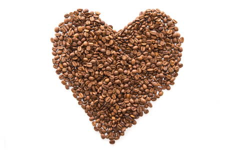 Heart shape made with coffee beans