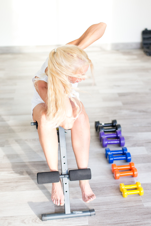 Fitness with young, blond woman Stock Photo