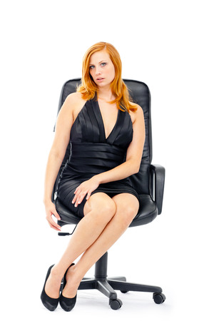 Woman sitting on the chair 스톡 콘텐츠