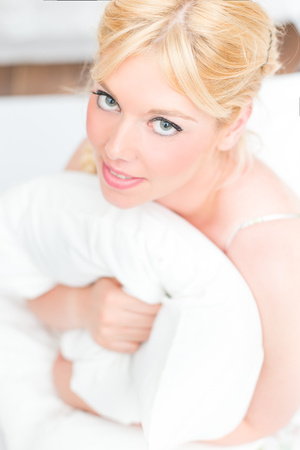 Beautiful blonde woman in the bed 스톡 콘텐츠