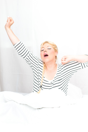 Beautiful blonde woman in the bed Stock Photo