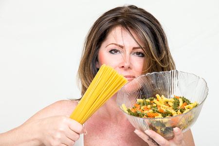 Woman with spaghetti Stock Photo