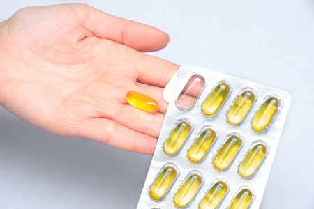 Nutrition. Healthy Lifestyle. Woman Holding Capsule With Fish Oil Omega-3. Supplements, Vitamins.