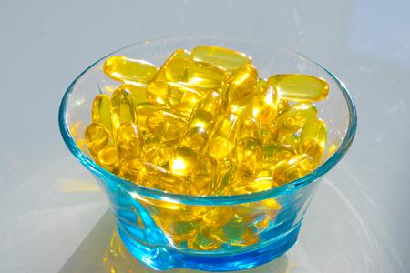 Omega 3 fish oil capsules in bowl