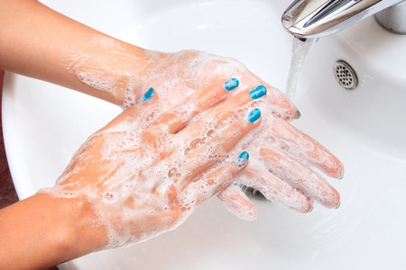 Soaped woman hands in the sink 写真素材