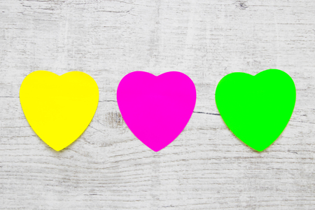Colorful Heart Note Papers on wooden