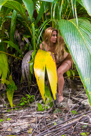 Wild woman hidden in the green jungle