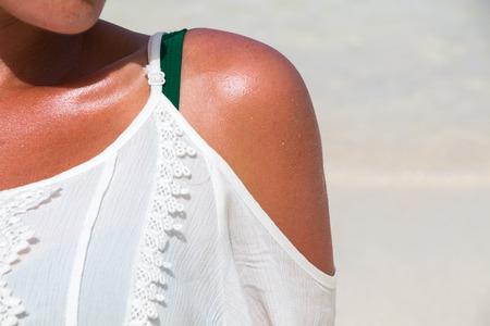 Woman shoulder under the sun at the dream beach Stok Fotoğraf