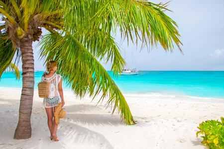 Beautiful woman under palm tree Stok Fotoğraf