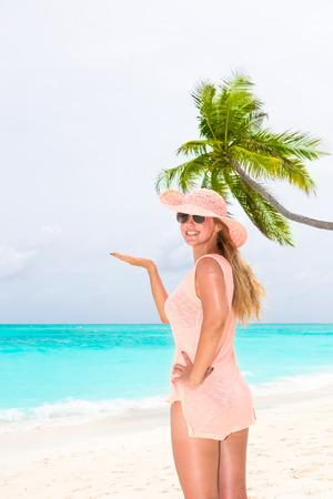 Beautiful girl on the coast of Maldives