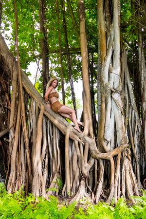Wild woman climbing on trees