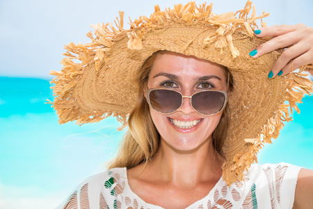 Gorgeous woman with sun hat on the dream beach