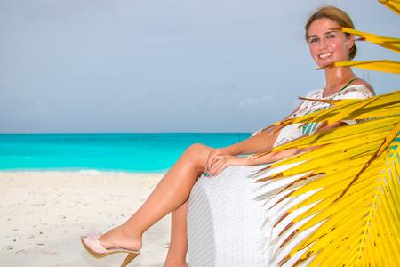 Young woman sitting on sofa at the beach 版權商用圖片