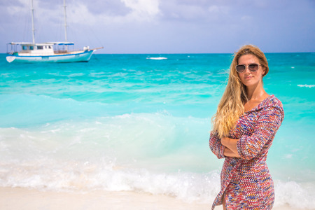 Blonde woman on the tropical beach