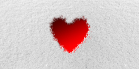 Red Heart in front of Snow Background