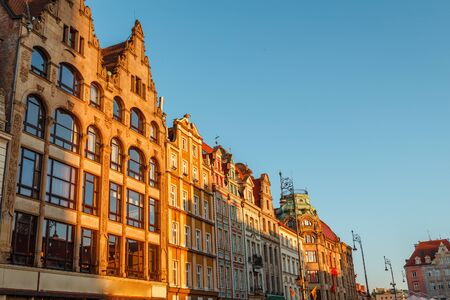 sunset over old houses in Wroclaw in Poland in spring