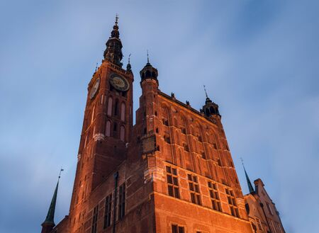 the building of the city hall of gdansk against the sky 스톡 콘텐츠