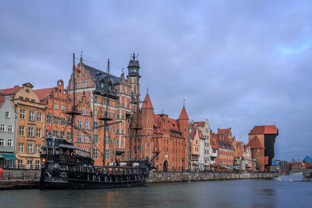 gdansk promenade in poland in winter with an old ship in the foreground