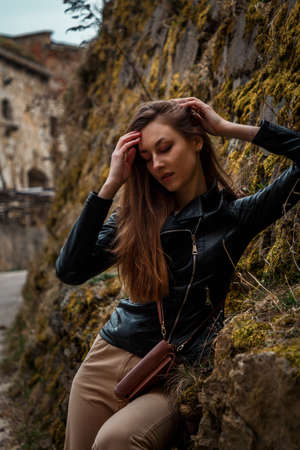 beautiful girl on the streets of the ancient Polish city spring