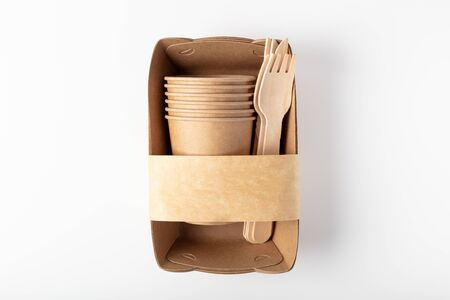 Organic eco packaging top view. Container, fork, knife and wooden Cup. On a white background