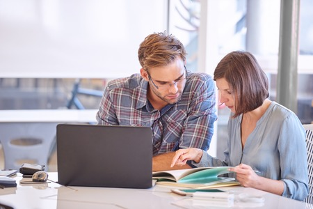 liquidity: Focused man and woman thinking hard and long about the future of their company, trying to make sure that their companys liquidity is not at stake. Stock Photo
