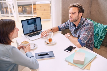 constructive: Man busy making a business presentation to a well know successful mature business woman who might be his future investor if everything goes well.