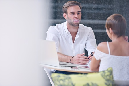 appears: Interview between accomplished male businessman and a potential new female employee who appears to be a promising candidate for the role in question, as he questions her thoroughly.