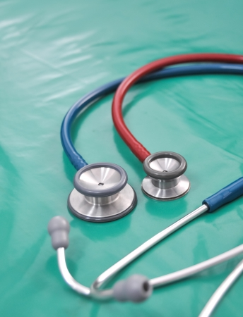 Stethoscope on green background